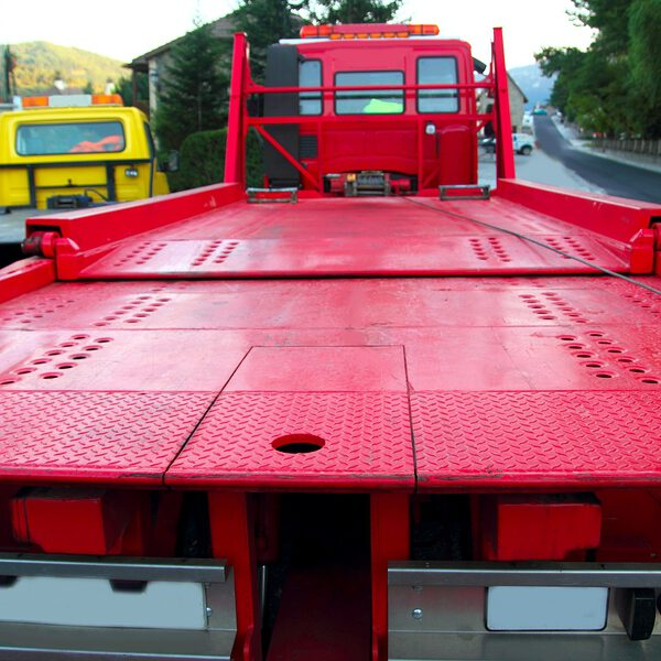 Tow car truck red rear view perspective platform outdoor street